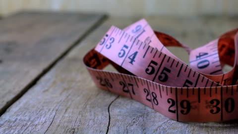 pan:gauge on wooden floor - tape measure stock videos & royalty-free footage