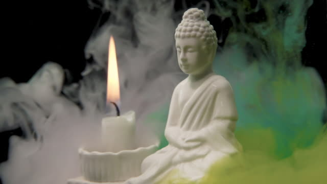 gautama buddha with colorful smoke - food coloring stock videos and b-roll footage