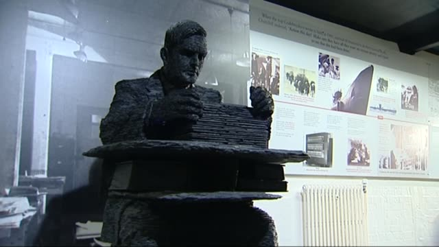 Gay and bisexual men to be given pardons TX Various shots of sculpture of Alan Turing with Enigma machine