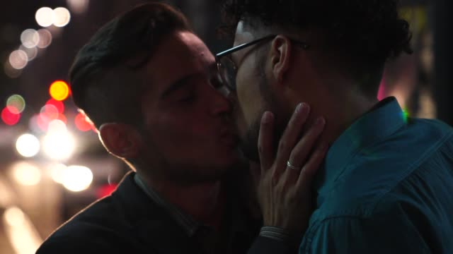 gay boys kissing after work at night - flirting stock videos & royalty-free footage