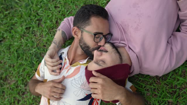 gay couple dating lying on grass - lying on back stock videos & royalty-free footage