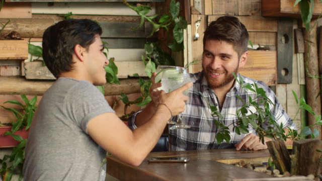 a gay couple drinking in a bar / medellin, colombia - sprache kommunikation stock-videos und b-roll-filmmaterial