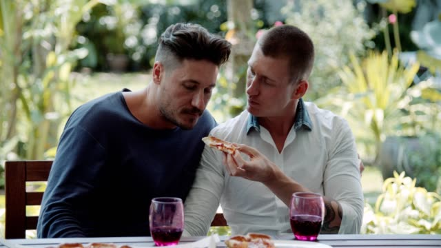 gay couple eating pizza - box container stock videos & royalty-free footage