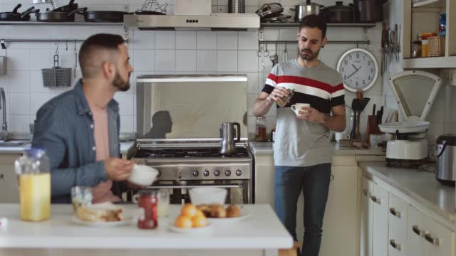 gay couple having breakfast at home - human relationship stock videos & royalty-free footage