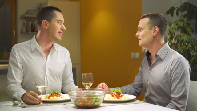 hd: gay couple having romantic dinner - evening meal stock videos and b-roll footage