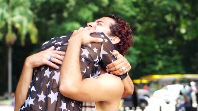 gay couple hugging after a long time without seeing each other - forgiveness stock videos & royalty-free footage