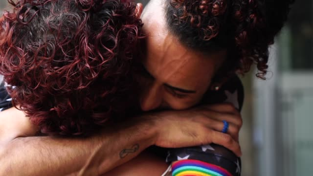 gay couple hugging after a long time without seeing each other - reconciliation stock videos & royalty-free footage