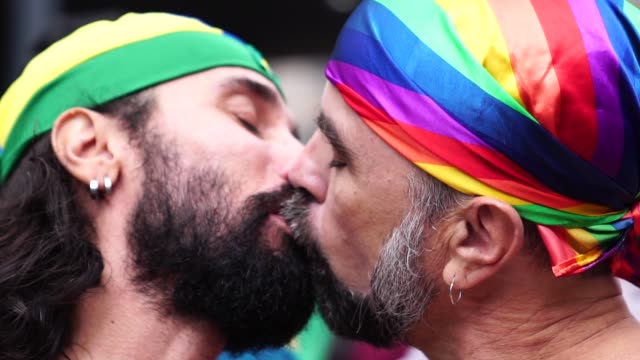 gay couple kissing on gay parade - 40 49 years stock videos & royalty-free footage