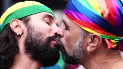 gay couple kissing on gay parade - kissing stock videos & royalty-free footage
