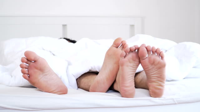 gay couple let's just stay in bed today for the weekend - human foot stock videos and b-roll footage