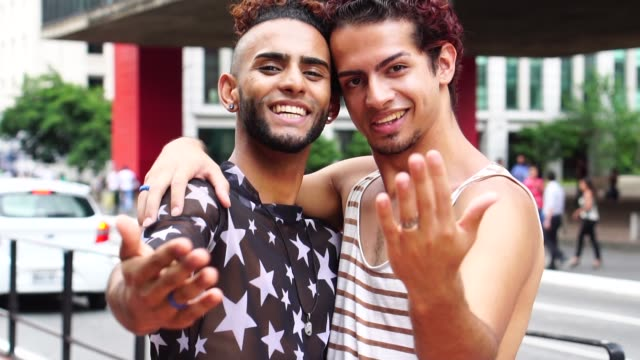 gay couple making gesture to come in the city - temptation stock videos & royalty-free footage