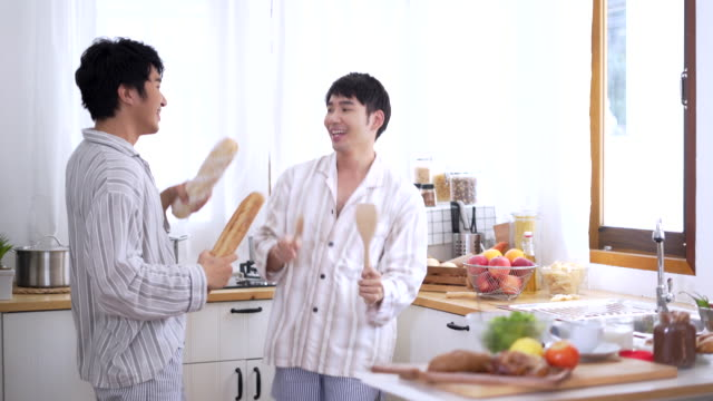 gay couple man cooking in a kitchen - nutritionist stock videos and b-roll footage