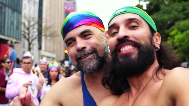 Gay couple taking a selfie at Gay Parade