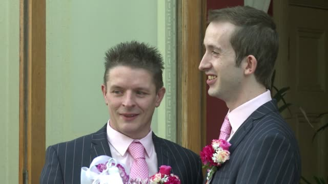 gay couples across england and wales said i do saturday as a law authorising same sex marriage came into effect at midnight the final stage in a long... - first occurrence stock videos & royalty-free footage