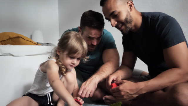gay couples and adoption - gay couple playing with adopted daughter at home - hungary stock videos & royalty-free footage