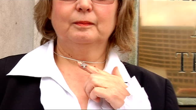 'Gay Cure' Christian adverts banned from London buses Nadia Eweida standing by Employment Appeal Tribunal sign as displaying crucifix necklace