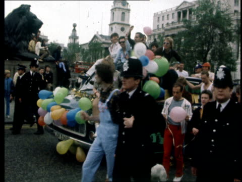 london trafalgar square ext ts demos some in fancy dress along rl ms float rl cms man with painted face carrying banner cs man with painted face pan... - face paint stock videos & royalty-free footage