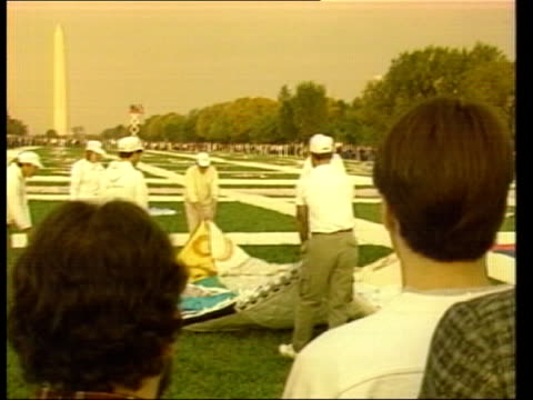 aids memorial quilt usa washington two men hug kiss as voice of woman saying names of dead men sof sunrise bv people stand facing capitol hill as sun... - kissing stock videos & royalty-free footage