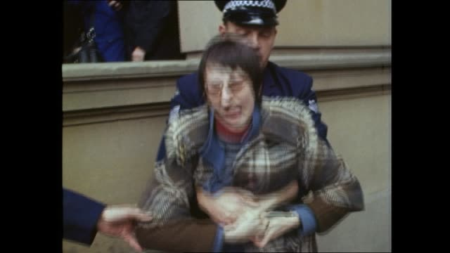 gay liberation demo outside court and march re police harrassment and arrests of homosexuals following mass arrests at an oxford street protest two... - gras stock videos and b-roll footage
