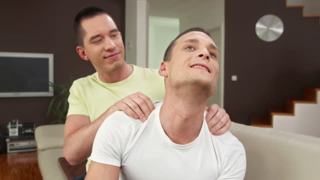 hd: gay man enjoying shoulder massage - mid adult men stock videos & royalty-free footage