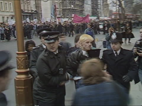 clause 28; b) england: london: whitehall: ext side horse guard l-r demonstrators towards along pavement tms demonstration towards cms michael cashman... - itv news at five stock videos & royalty-free footage