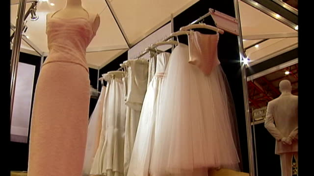 government faces backbench revolt **music heard over following** wedding dresses displayed at trade fair wedding couple dolls on cake - itv weekend lunchtime news点の映像素材/bロール