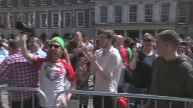 gay marriage campaigners celebrate a 'resounding victory'; ireland: dublin: ext crowds cheering people in square and clapping - dublin republic of ireland stock videos & royalty-free footage