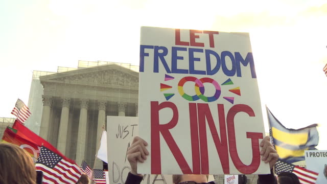 gay marriage supporters rally against doma at supreme court on march 27 2013 in washington dc - oberstes bundesgericht der usa stock-videos und b-roll-filmmaterial