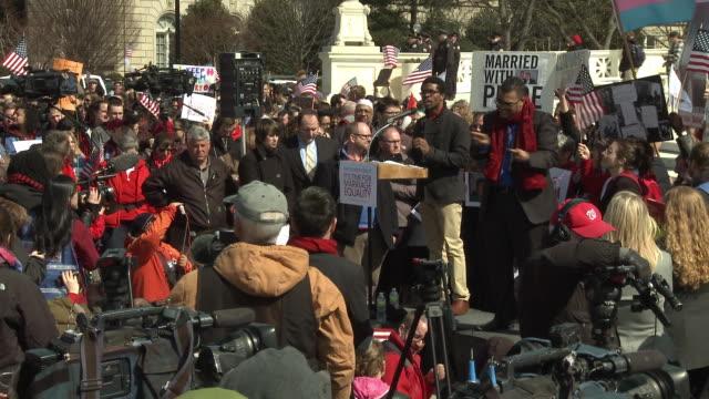 gay marriage supporters rally against doma at supreme court on march 27 2013 in washington dc - corte suprema palazzo di giustizia video stock e b–roll