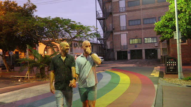 gay men walking in the evening on a first date together - spectrum stock videos & royalty-free footage