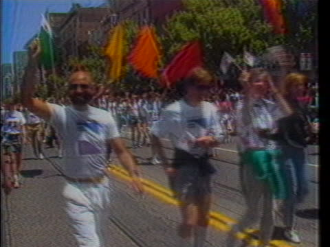 gay rights advocates carry a banner for theê2ndêannual gay games in downtown san francisco, california. - human rights or social issues or immigration or employment and labor or protest or riot or lgbtqi rights or women's rights stock videos & royalty-free footage