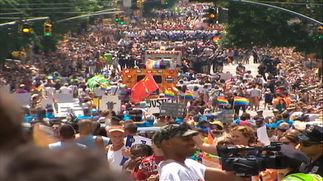 gay rights advocates in celebrate during the gay pride parade in new york city. - parade stock videos & royalty-free footage