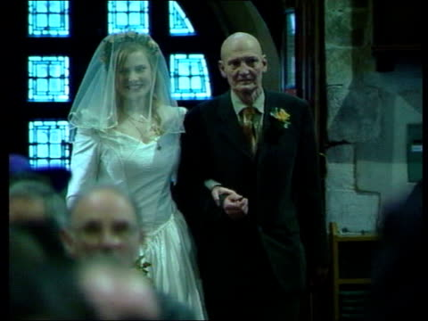 tories oppose lib bride and her father beginning the walk down the aisle of church as congregation stand bride joining groom at the altar lib london... - father of the bride stock videos and b-roll footage