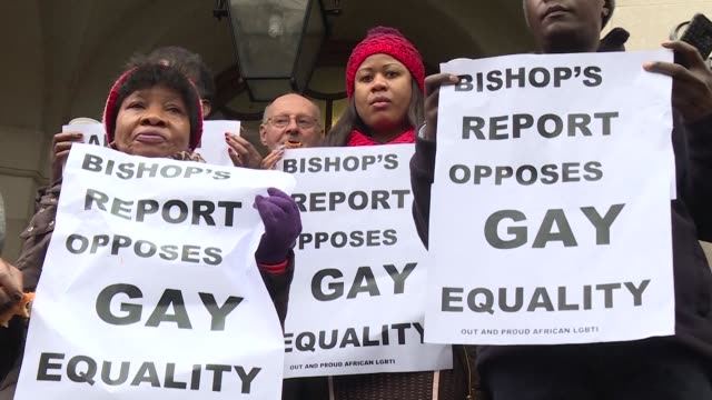 gay rights campaigners protest outside the church of england's general synod in london as anglican bishops from around the world prepare to vote on a... - synod stock videos & royalty-free footage