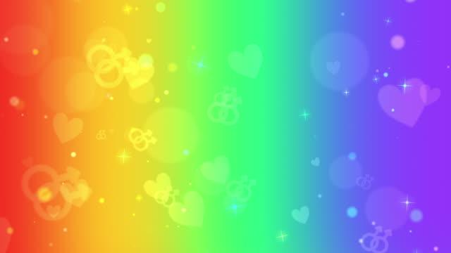 vídeos y material grabado en eventos de stock de gay symbols and hearts on vertical rainbow colors looping background - arco iris