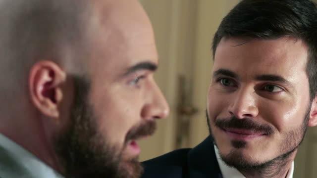 vídeos de stock e filmes b-roll de gay wedding ceremony at registry office - law