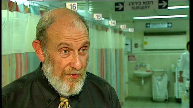 un demands inquiry / international condemnation ashkelon setup shot of dr ron lobel with reporter doctor ron lobel interview sot saying most of the... - ashkelon stock videos and b-roll footage