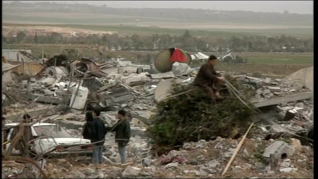 demands inquiry / international condemnation; january 2009: israel: gaza: gaza city: ext people scavaging amongst rubble of buildings - gaza city stock videos & royalty-free footage