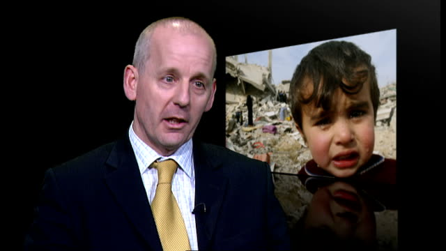 gaza appeal screened by broadcasters except bbc and sky news; england: london: int lindsay boswell interview sot - device screen stock videos & royalty-free footage
