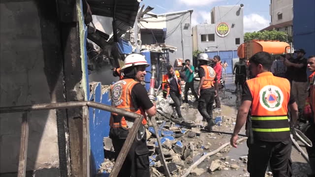 gaza city - aftermath of 11-day conflict between hamas and israel. factories, residential buildings, commercial buildings and a clinic damaged... - air raid stock videos & royalty-free footage