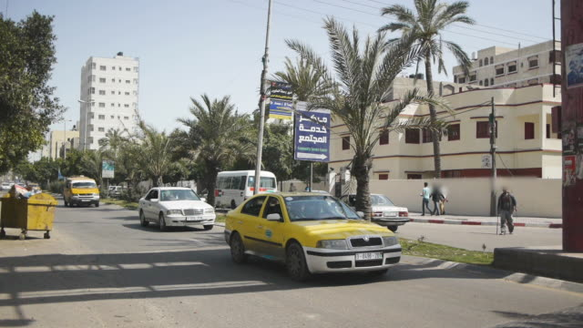 gaza city yellow taxi - gaza city stock videos & royalty-free footage
