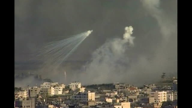 attacks continue despite un calls for ceasefire; israel: israel-gaza border: ext israeli airstrike over gaza town, smoke from mortars being fired - ceasefire stock videos & royalty-free footage