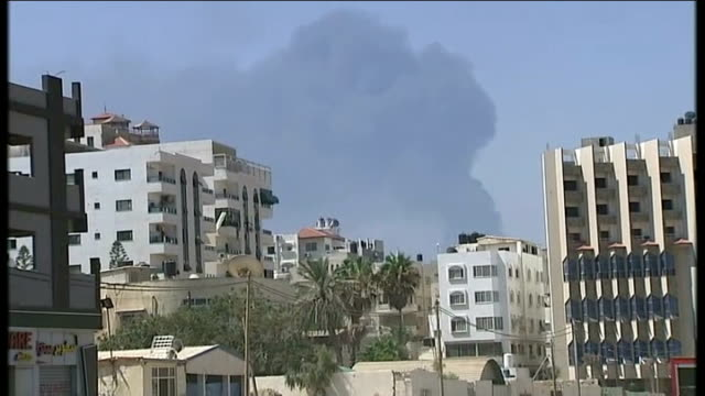 scores of palestinians killed as israeli bombardment continues damaged tv station building with sign 'tv press' tilt up damaged tv station building... - gaza strip stock videos & royalty-free footage