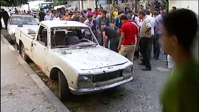 ten killed in alshati refugee camp missile strike people on crowded street men standing next to cars with leaves on roof pull out shrapnel damaged... - gaza strip stock videos & royalty-free footage