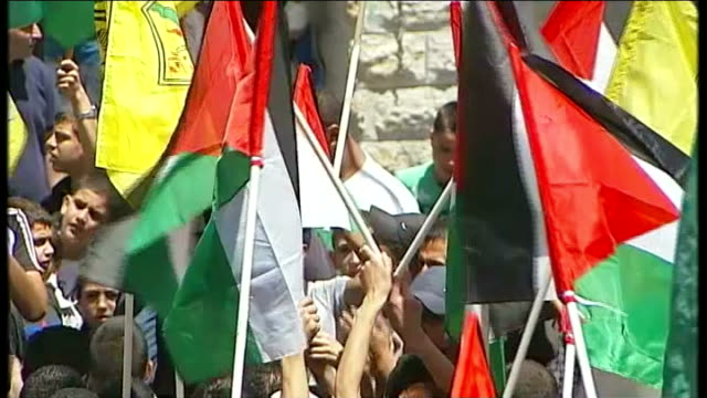 violence erupts in west bank and gaza on 'day of rage' minaret as sermon heard sot high angle views of crowd of men many with palestinian flags or... - israel palestine conflict stock videos & royalty-free footage