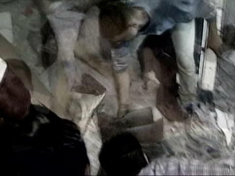 vídeos de stock, filmes e b-roll de gaza: ext slow motion palestinians clearing rubble after bombing raid by israeli forces still salah shehada slow motion palestinians among rubble... - air raid