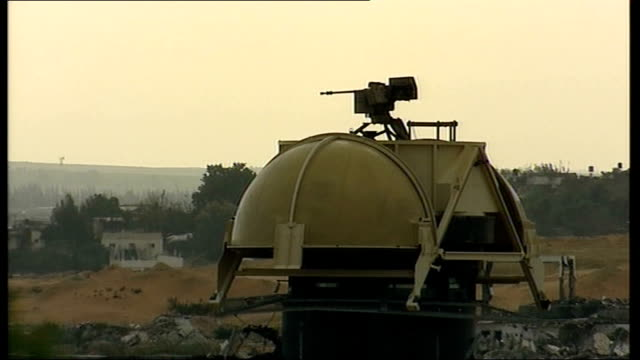 ceasefire calls rejected; israel / gaza border: armoured dome on gaza border with remote control machine gun reporter to camera - gaza strip stock videos & royalty-free footage