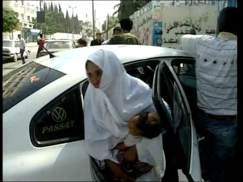 israeli offensive un warns of rapidly deteriorating situation bari and family getting out of car at another school high angle view of people in... - hands behind head stock videos & royalty-free footage