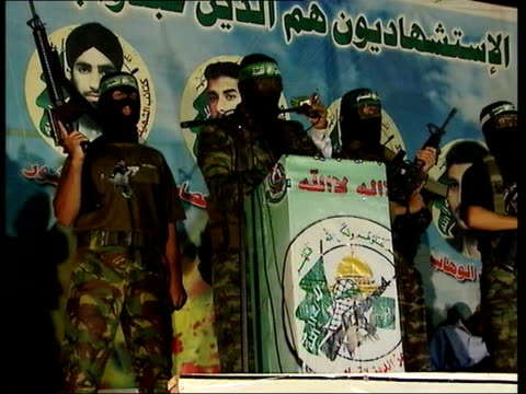 united nations official says israeli blockade of gaza must end armed and masked members of hamas resistance on stage - gaza strip stock videos & royalty-free footage