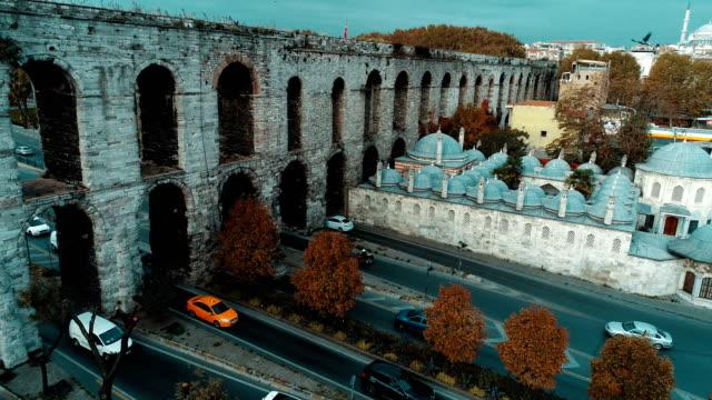 Gazanfer Agha Madrasah and Valens Aqueduct Istanbul Aerial Drone Shot at Sunrise